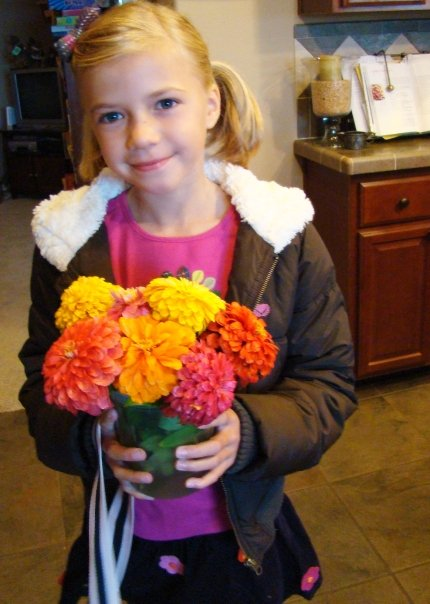 Bella with bouquet 3rd grade www.whatmattersmost.typepad.com